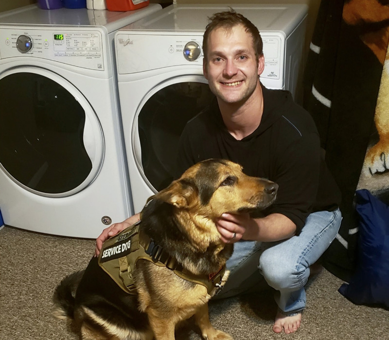 Veteran Scott Spearitt with Service Dog